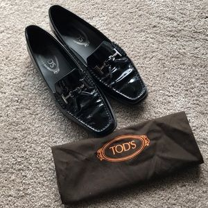 Black classic Tod's patent leather loafers